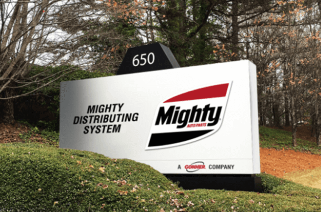 Mighty Distributing System Sign